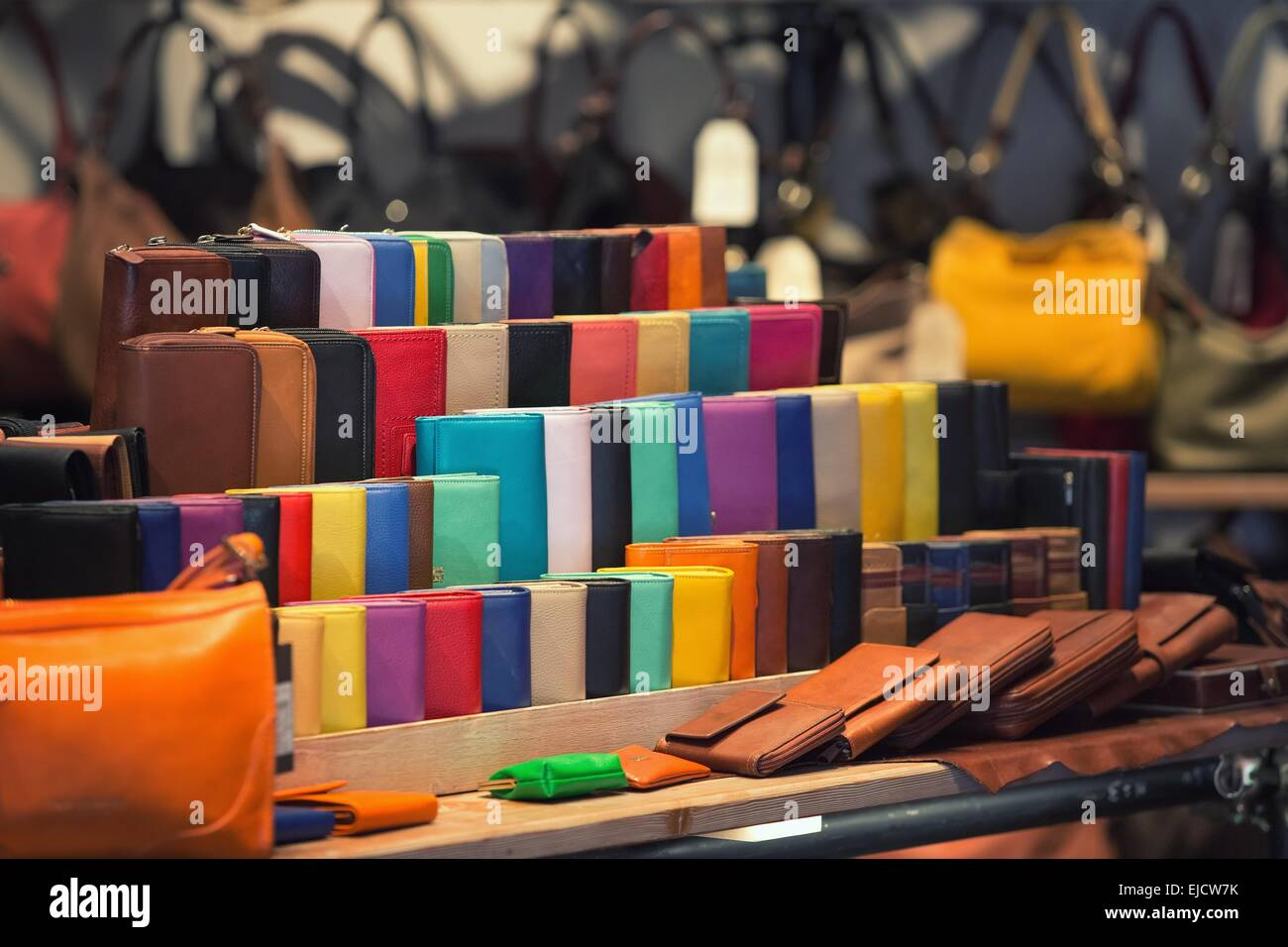 Many kinds of purses in different colors Stock Photo