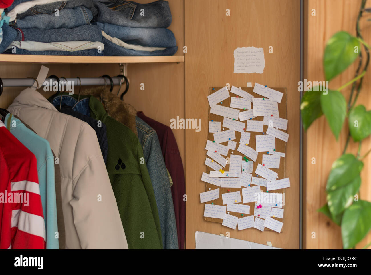 Collection of sayings on Wall in wardrobe - Stock Image