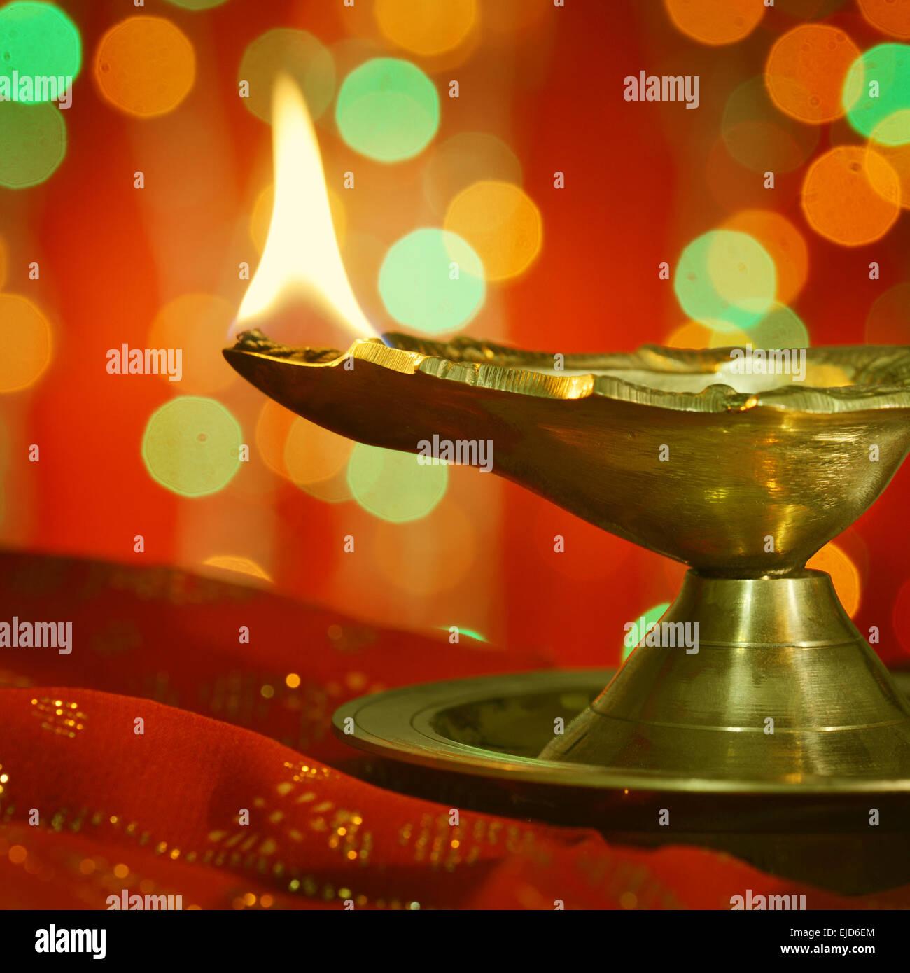 A metallic traditional indian lamp illuminated in dark diwali stock a metallic traditional indian lamp illuminated in dark diwali greetings m4hsunfo