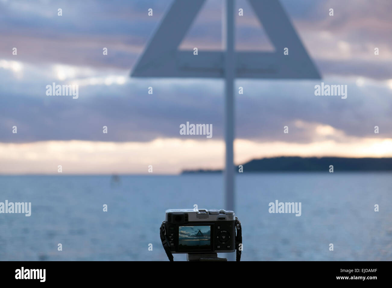 Fujifilm X100 camera set up on a tripod with scene visible in rear screen at Lake Taupo, New Zealand. - Stock Image