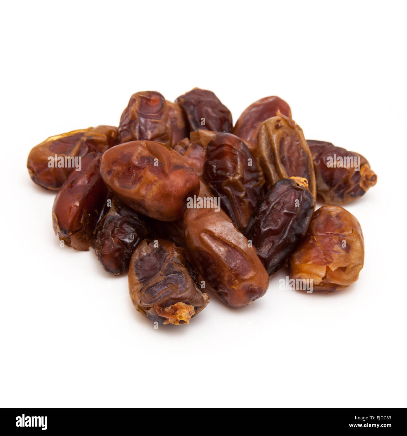 Halawi dates isolated on a white background.  Halawi dates originate from date trees in the deserts and farms of - Stock Image