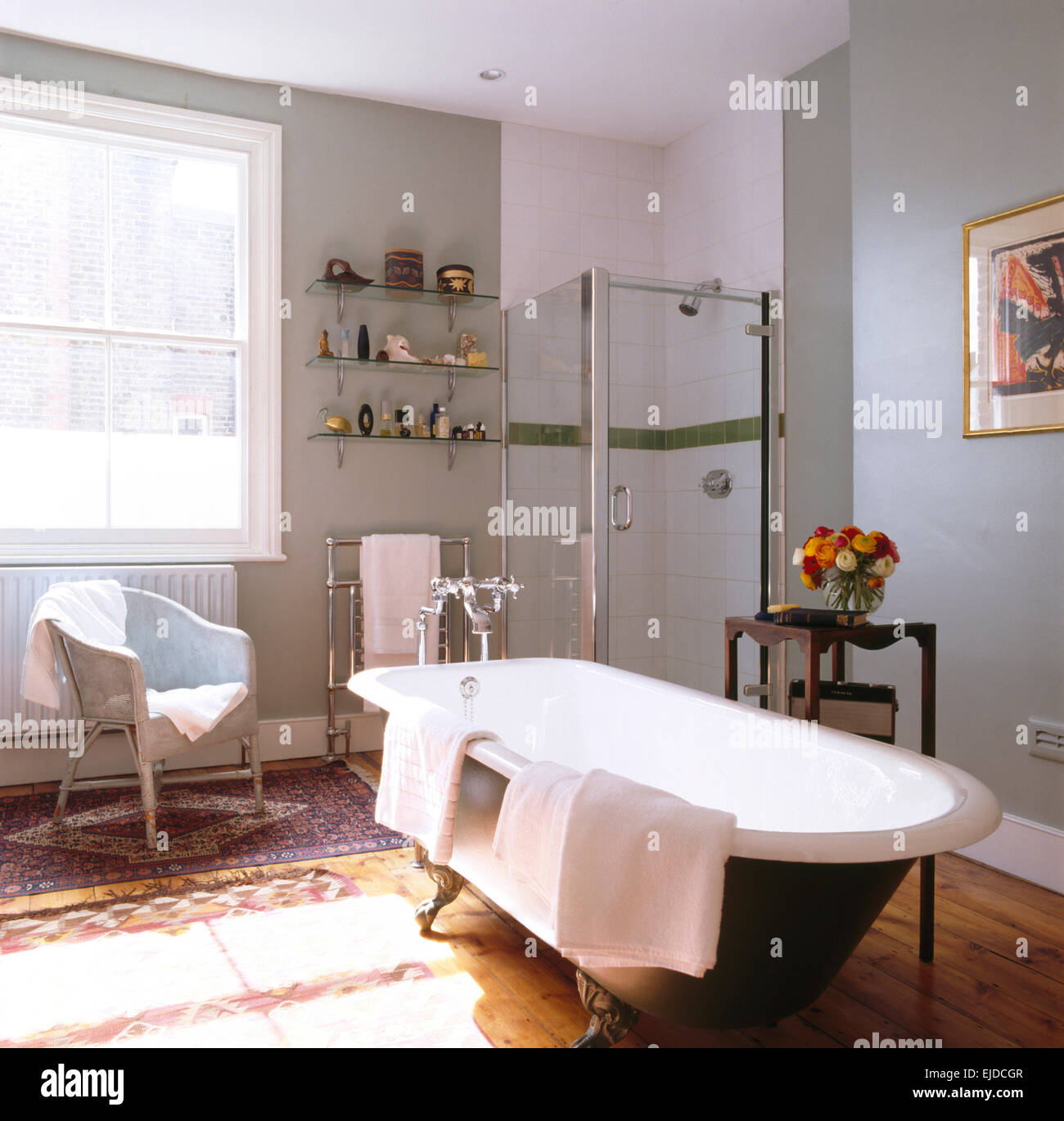 Rolltop bath and glass shower carbinet in pastel blue townhouse ...