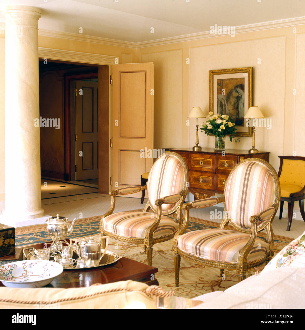 French style chairs in nineties drawing room with silver tea ...