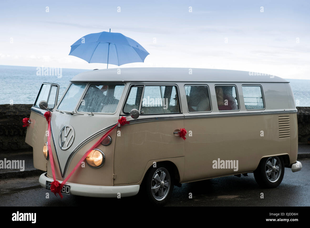 Vintage Volkswagen VW Bus ca. 1965 decorated for a wedding on a rainy day in St. Ives Cornwall England UK Europe - Stock Image