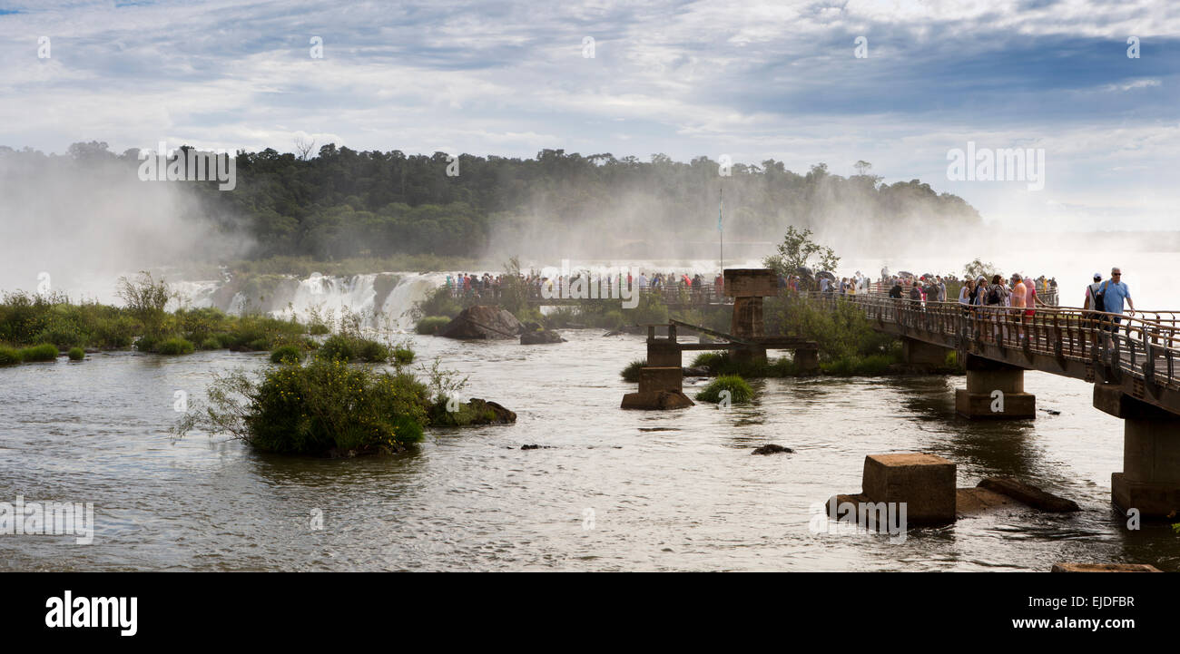 Argentina, Iguazu Falls National Park, tourists at Garganta el Diablo waterfall viewpoint, panoramic - Stock Image