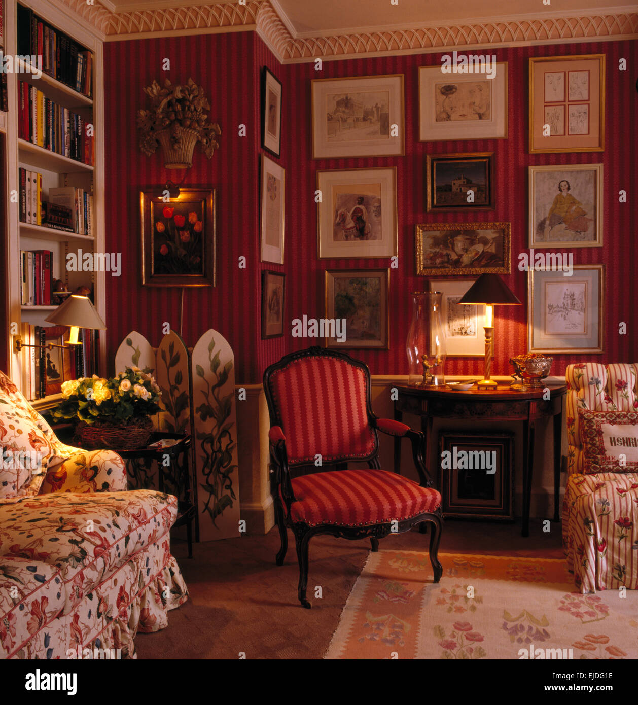 Red striped chair and floral sofa in nineties living room ...