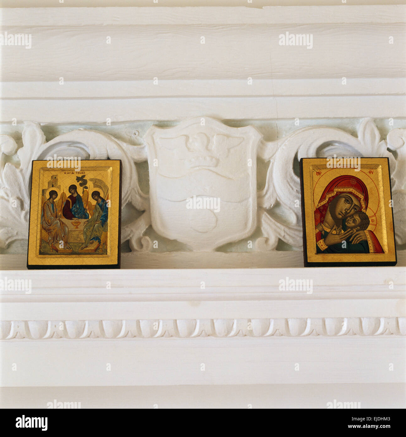 Close-up of medieval religious icons on an ornate cornice - Stock Image