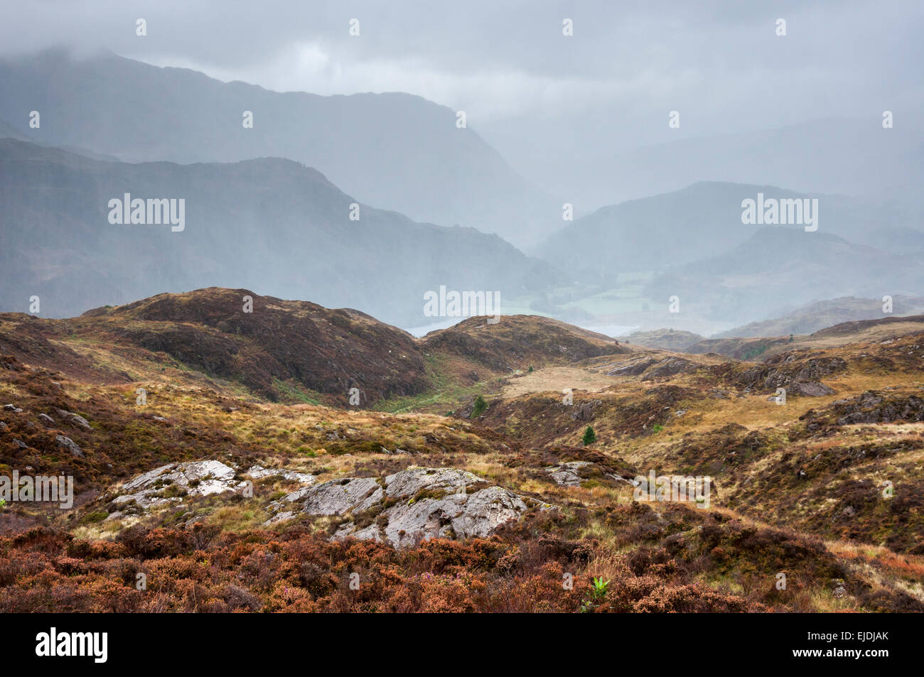 Dramatic rainy weather in Snowdonia. Rain falling on hills and mountains near Beddgelert. Stock Photo