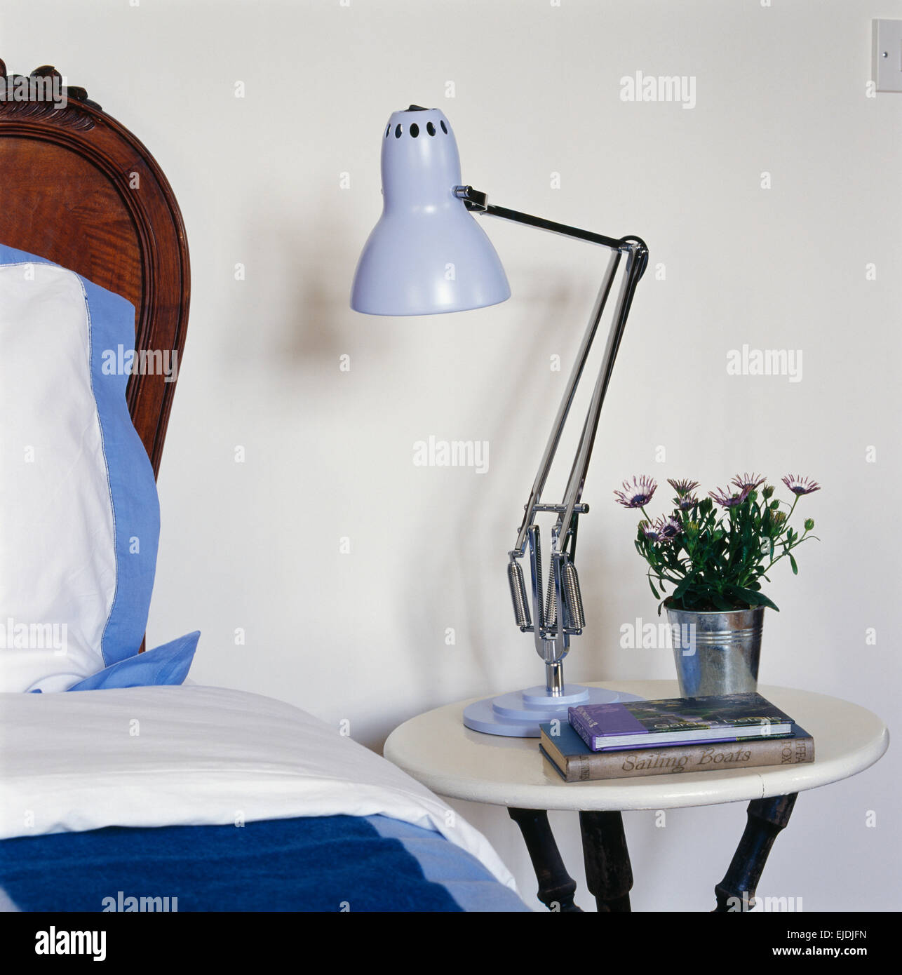 Pale blue anglepoise style lamp on small circular bedside table pale blue anglepoise style lamp on small circular bedside table watchthetrailerfo
