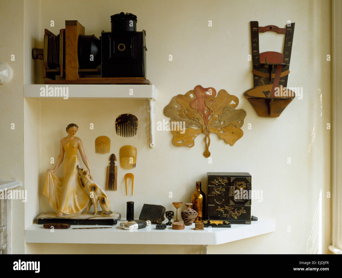 Shelves with a collection of thirties artefacts - Stock Image