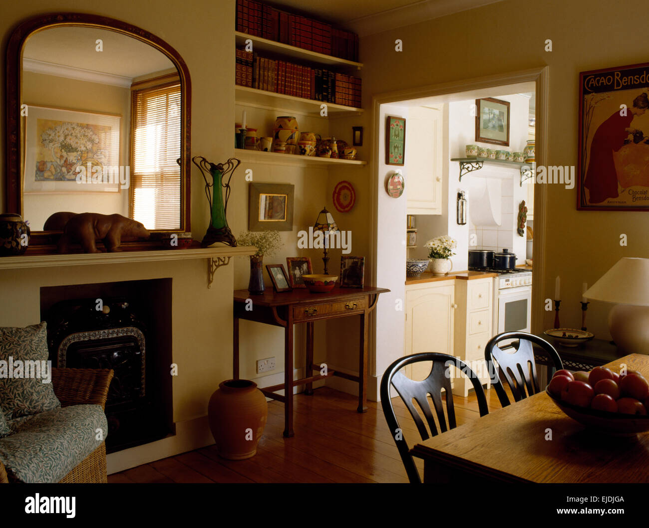 Victorian Mirror Above Fireplace In Nineties Dining Room With Doorway Stock Photo Alamy