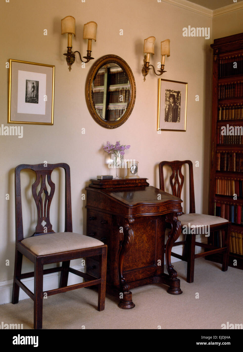 Dining Chairs On Either Side Of Small Antique Desk In Old Fashioned Study