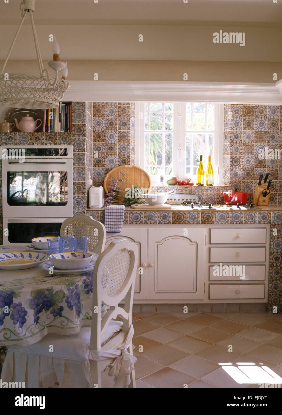 French Country Kitchen Tile Flooring patterned wall tiles and worktop in french country kitchen with