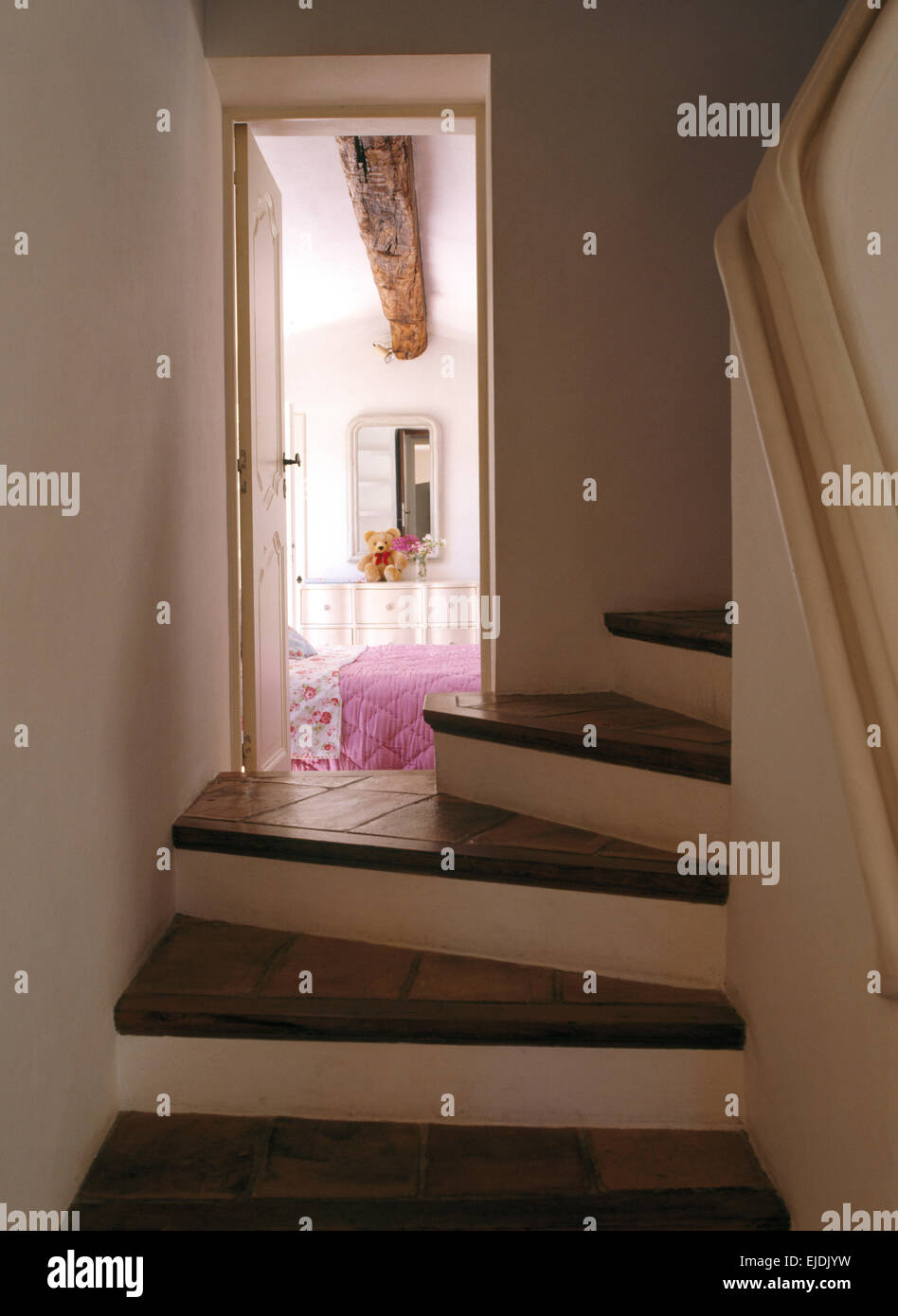 Tiled Stone Treads On Staircase With Open Door To French Country Bedroom