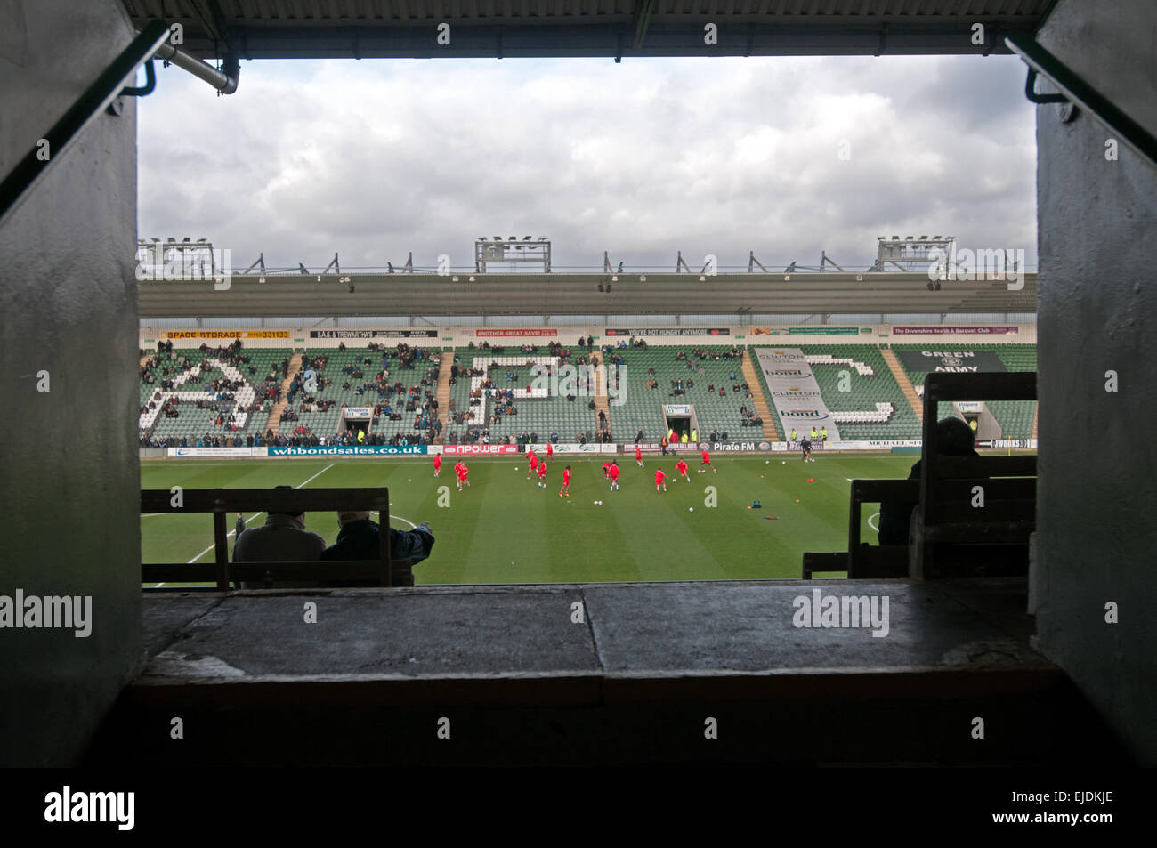 Players warm up at Plymouth Argyle FC - Stock Image