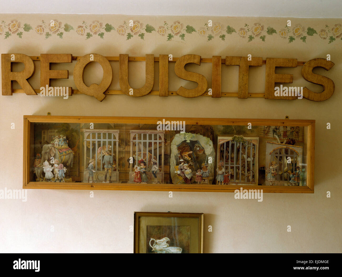 Wooden letters on wall above tableau boxes - Stock Image