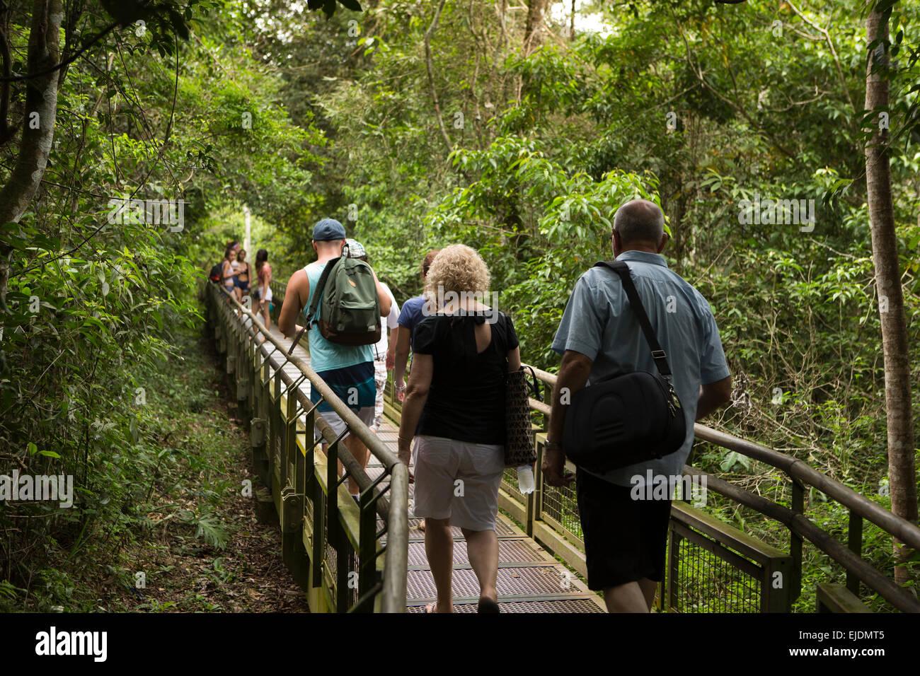 Argentina, Iguazu Falls, tourists on Circuito Inferior, lower circuit walkway - Stock Image