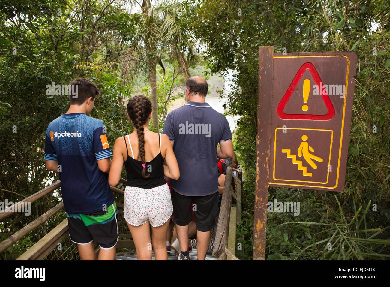 Argentina, Iguazu Falls, Circuito Inferior, lower circuit walkway, danger, slippery step warning sign - Stock Image