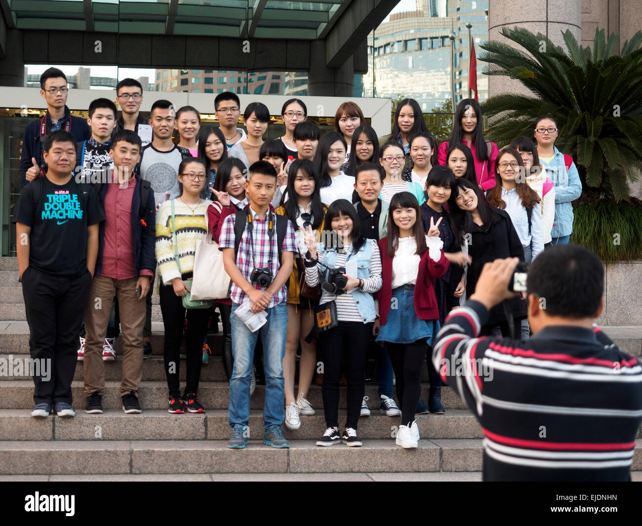 Asian teenagers posing for a group shot - Stock Image