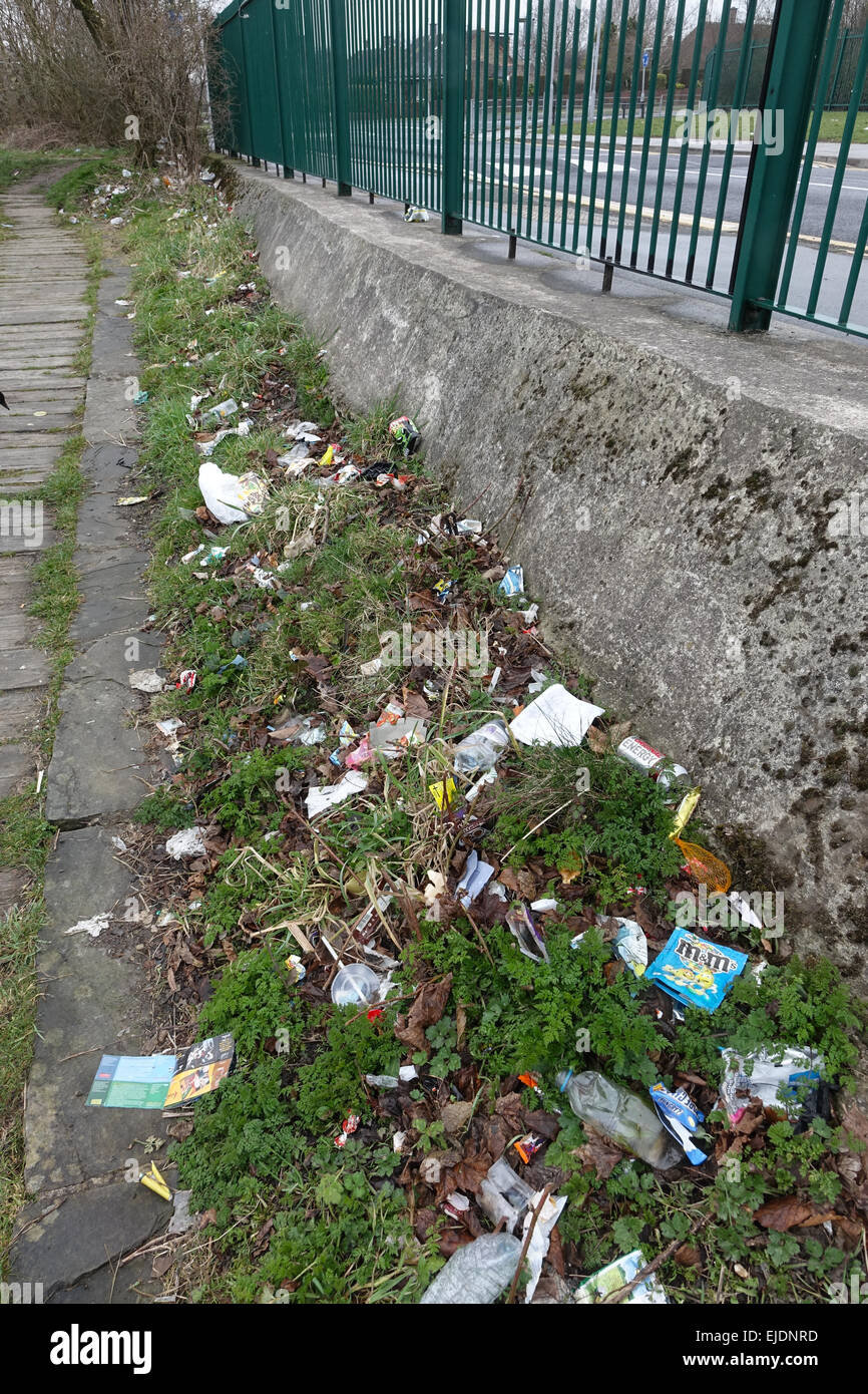 Litter, trash, plastic, glass, bottles, cans, bags and fast food cartons around a council estate in Bradford, West Yorkshire. Stock Photo