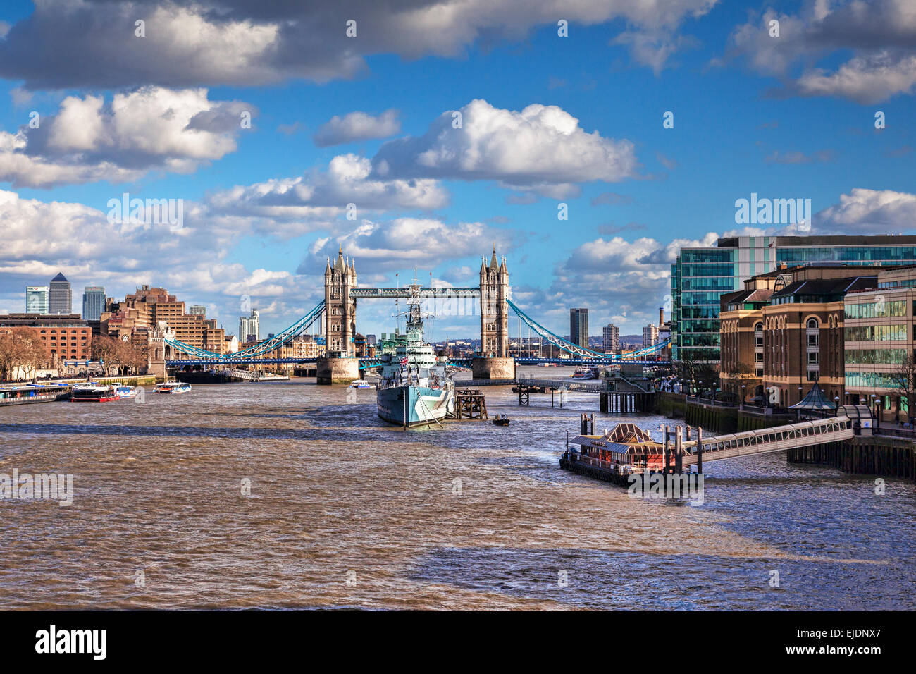 HMS Belfast on the River Thames, and Tower Bridge, London. - Stock Image