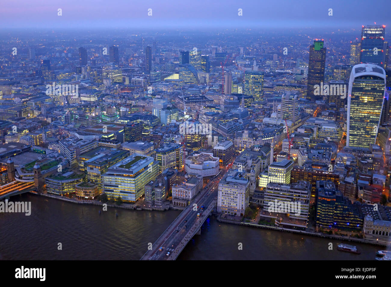 London rooftop view panorama at sunset with urban architectures with Thames River at night - Stock Image