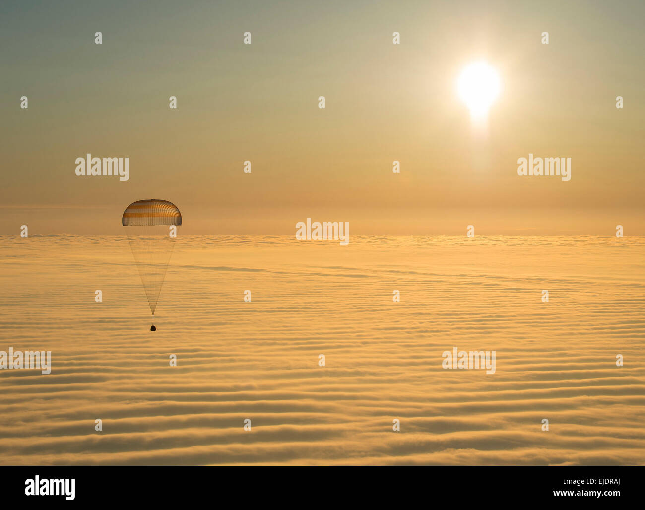 The Soyuz TMA-14M spacecraft is seen as it lands with Expedition 42 commander Barry Wilmore of NASA, Alexander Samokutyaev - Stock Image