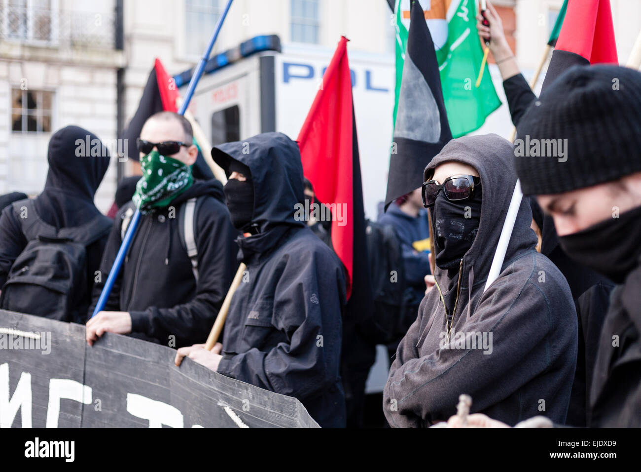 'Black-bloc' anti-capitalist protesters assemble in Lincoln's Inn Fields in central London ahead of a climate change - Stock Image