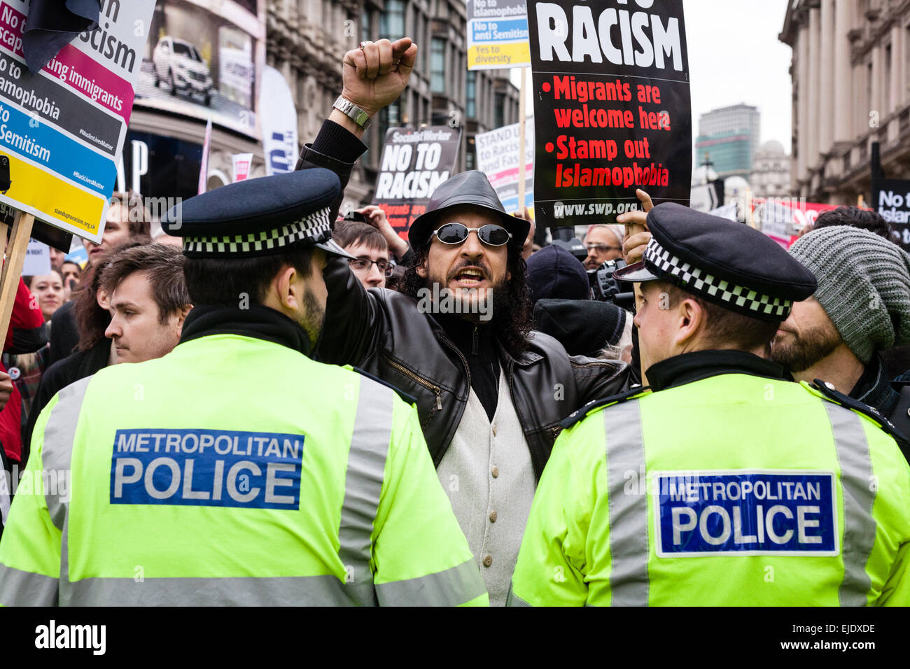 An anti-racism demonstrator shouts towards supporters of far-right group Britain First during a rally in central - Stock Image