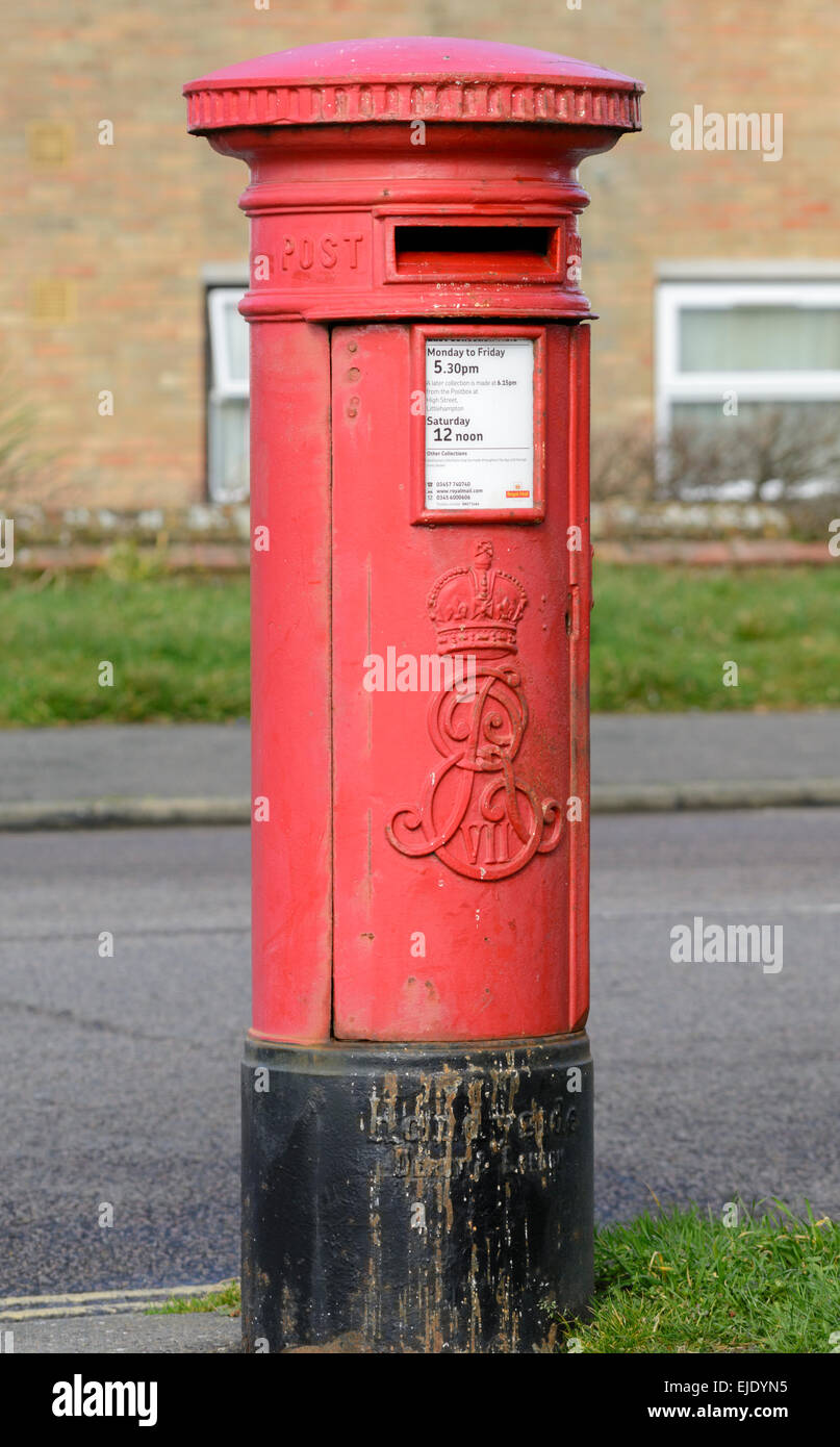 Red postbox. Royal Mail Pillar Box in England, UK. Postbox red. Red letterbox. Red letter box. - Stock Image