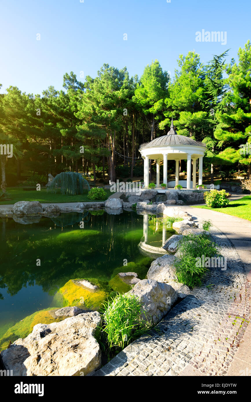 White arbour near beautiful lake in park - Stock Image