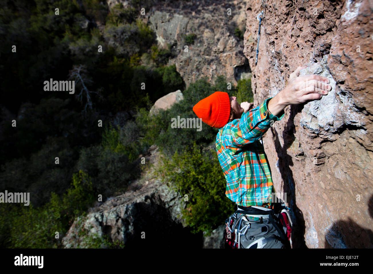5f0a843e0c3 A male climber in an orange beanie and multicolored shirt climbs Family  Jewel (5.10d