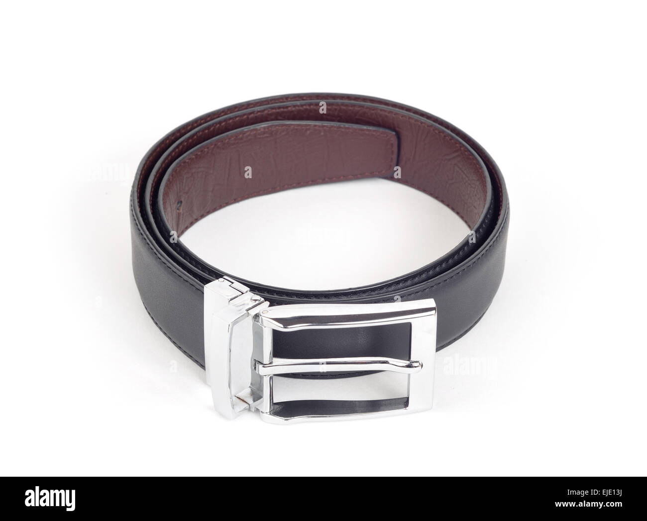 bilateral black and brown leather belt on white background - Stock Image