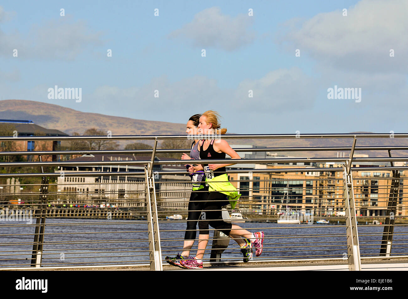 Runners participating in a half-marathon race in Londonderry, Derry, Northern Ireland - Stock Image