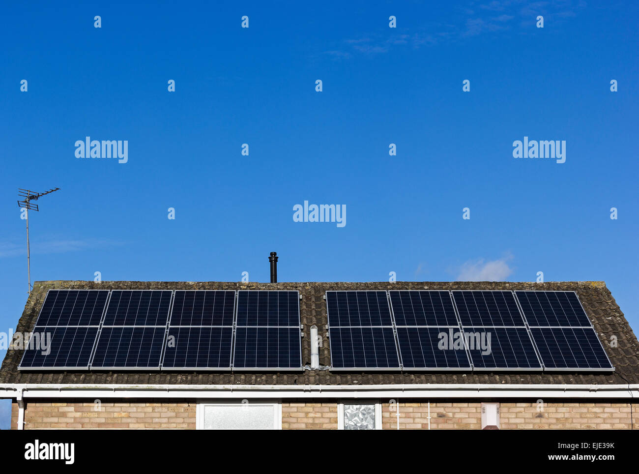 Roof of a domestic house with solar panels. - Stock Image