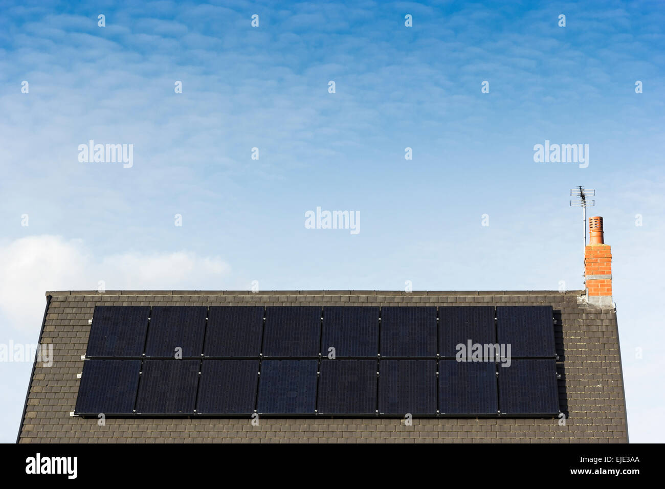 Solar panels on the roof of a domestic home - Stock Image