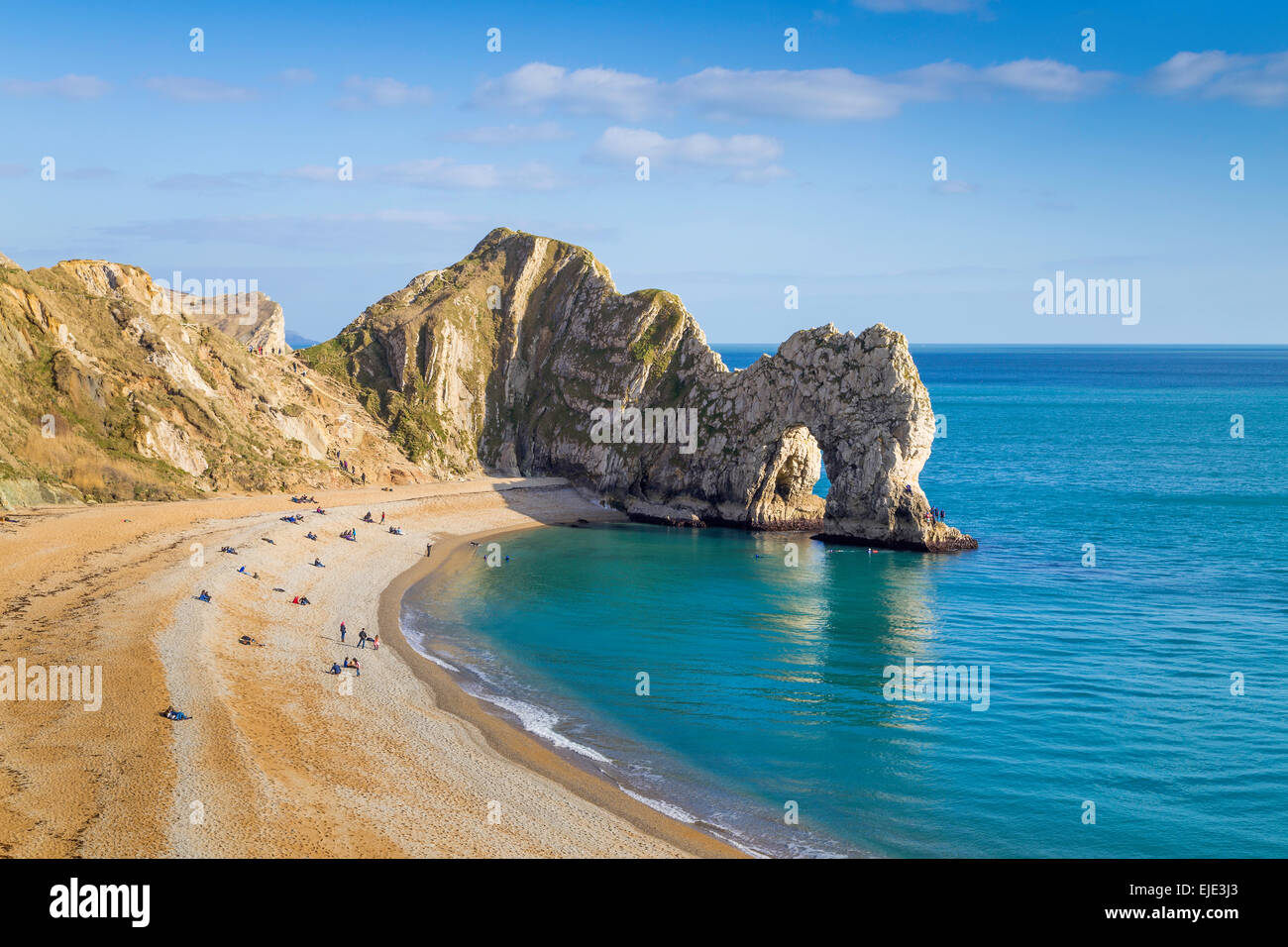 The sea arch at Durdle Door on a sunny day. Dorsetu0027s most famous landmark on & Sunlight Durdle Door Stock Photos u0026 Sunlight Durdle Door Stock ...