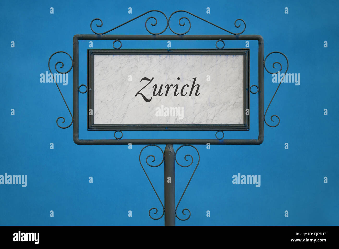 Zurich on a Signboard. Light Blue Background. - Stock Image