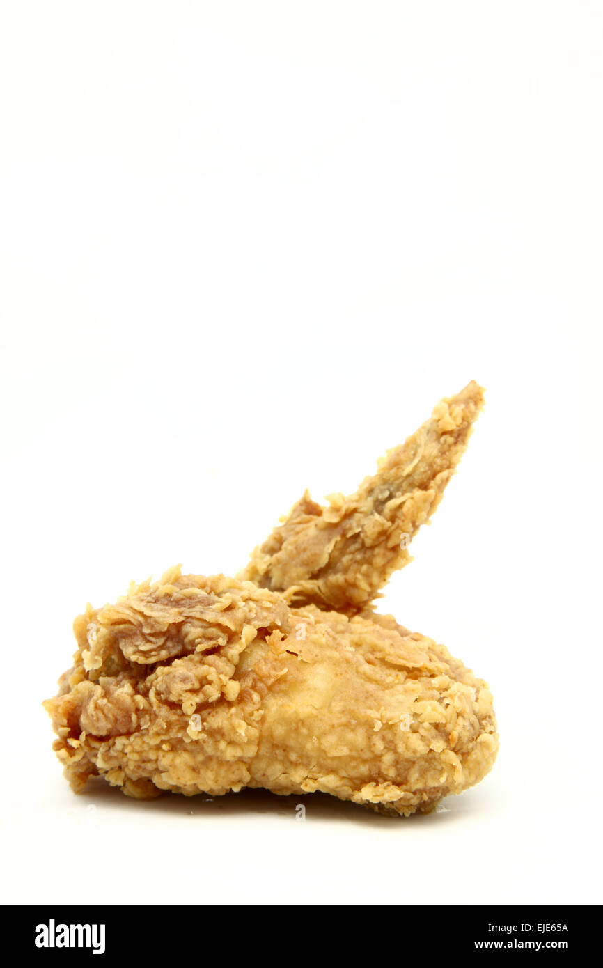 isolated deep fried chicken wing - Stock Image