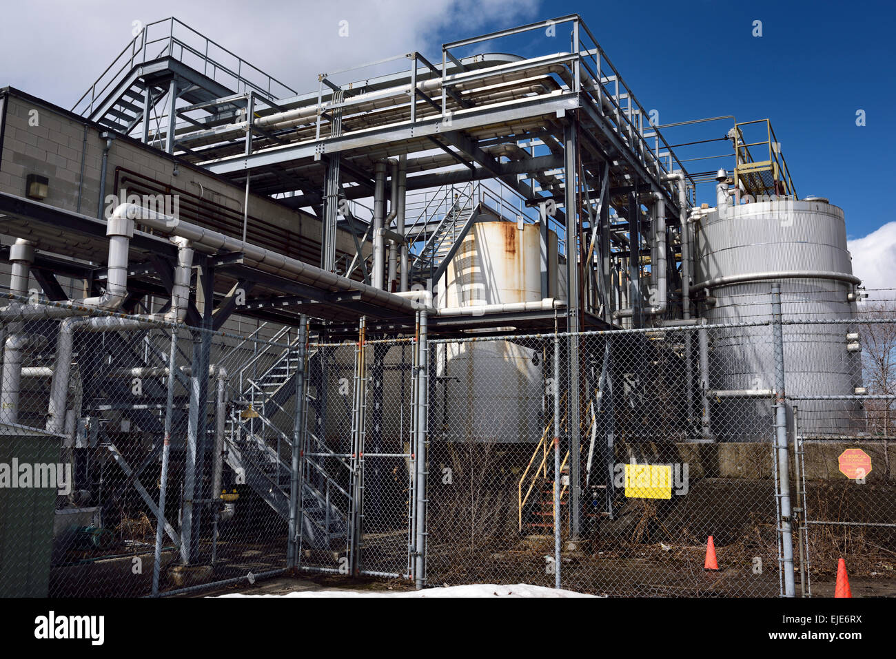 Storage area with metal tanks and pipes at a chemical plant Toronto - Stock Image