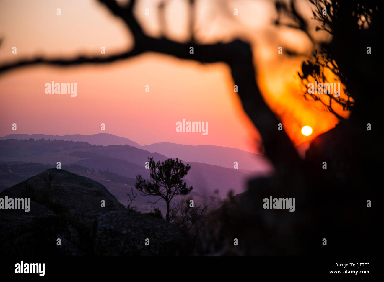 A sunset as seen from a hill in Swaziland, Africa. - Stock Image