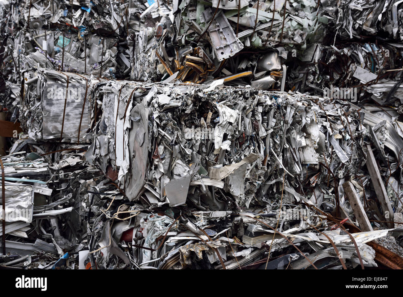 Close up of crushed recycled scrap metal bales at a dump in Toronto - Stock Image