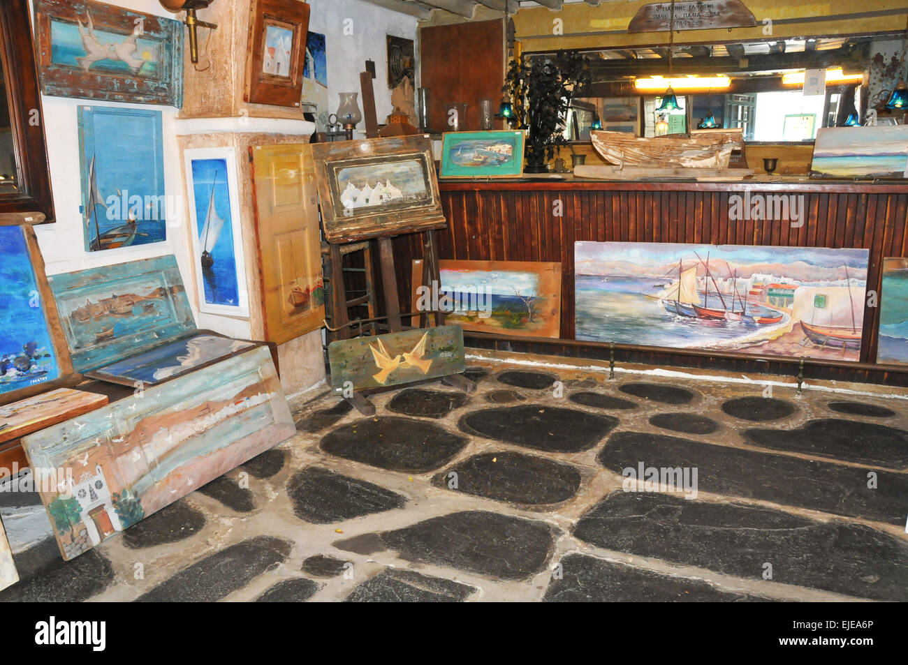 Art store with paintings in Mykonos Gre,ece. - Stock Image