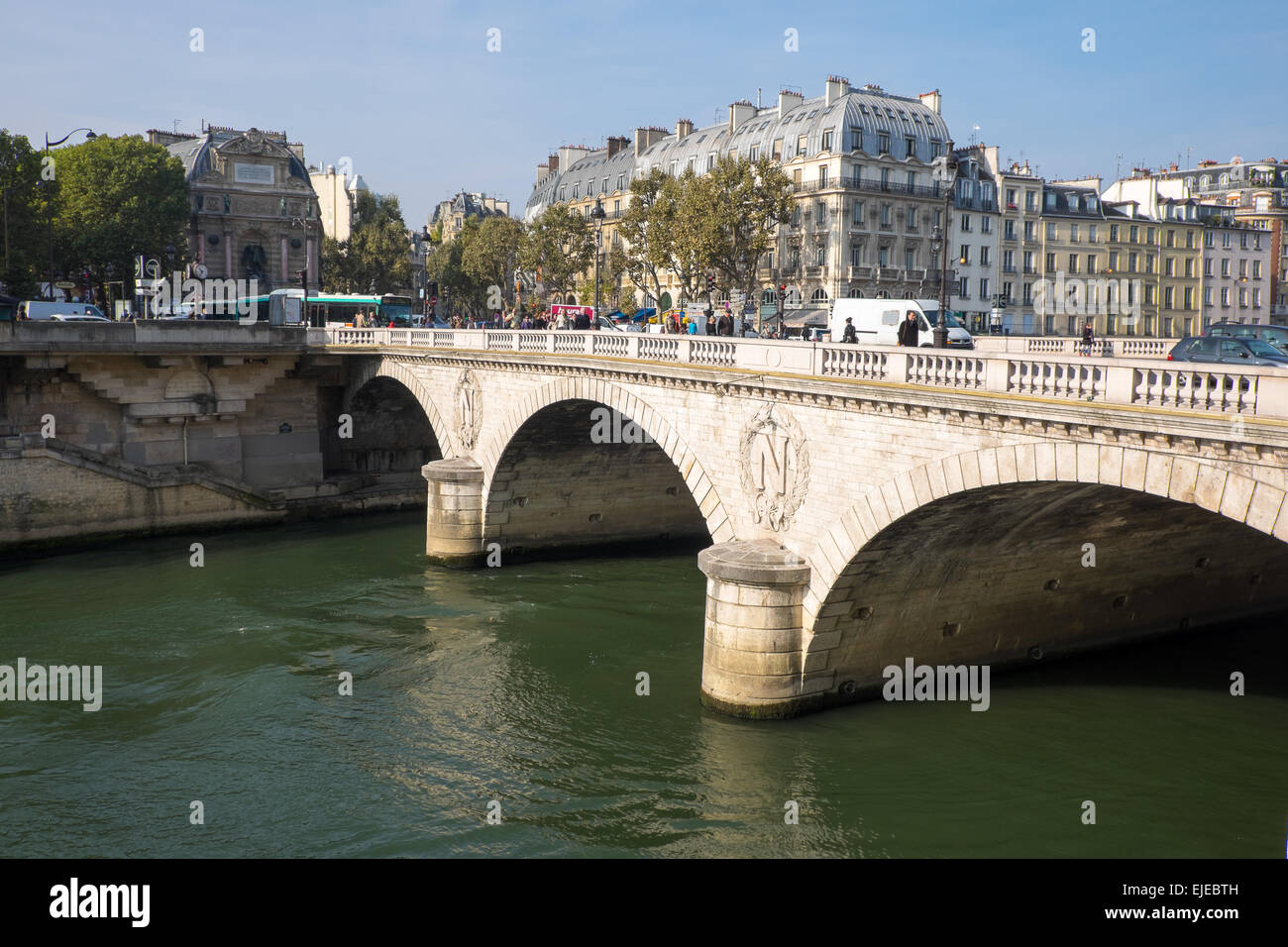 The Pont Au Change bridge, bearing the imperial insignia of Napoleon, crosses the River Seine in Paris, France. - Stock Image