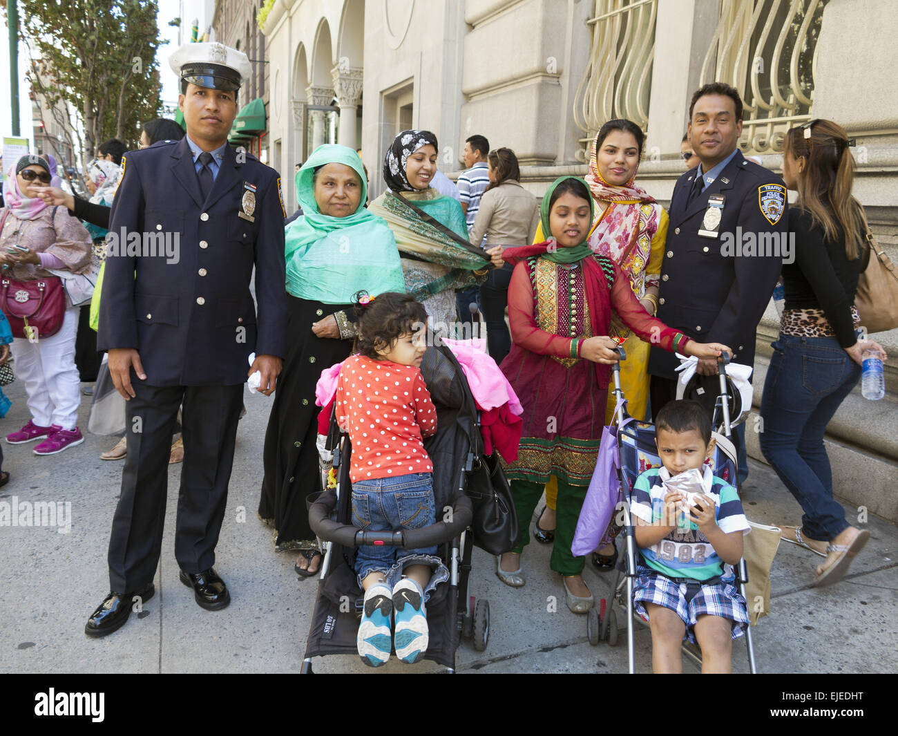 Muslim NYPD police officers and their families at the Muslim American Day Parade n New York City, 2014. - Stock Image