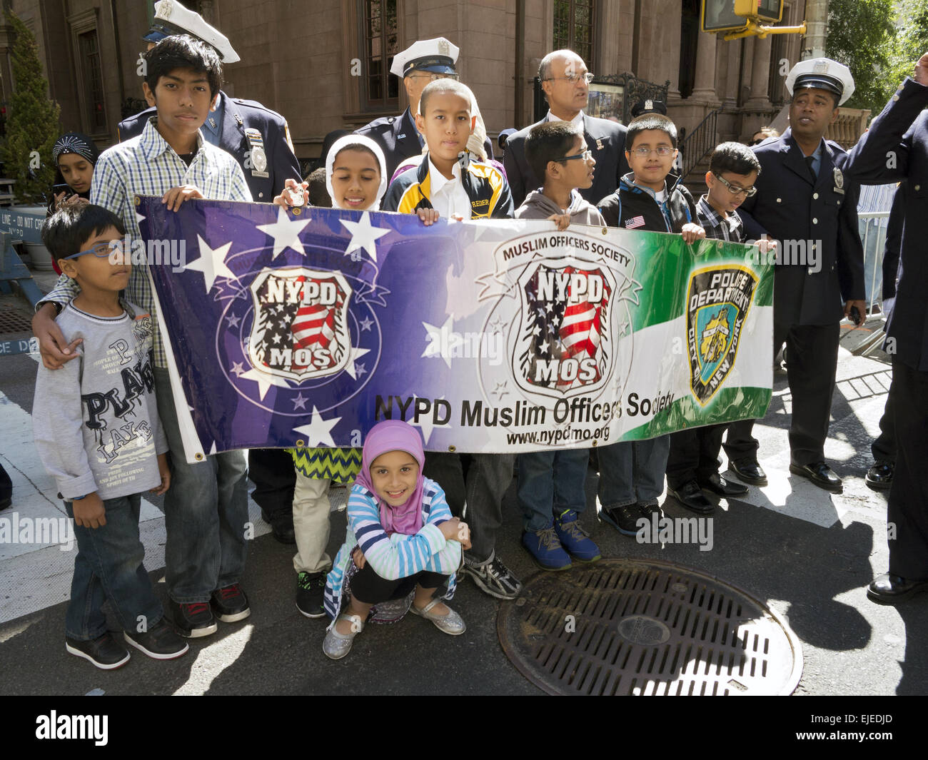 Muslim NYPD police officers and their families at the Muslim American Day Parade n New York City, 2014.. - Stock Image