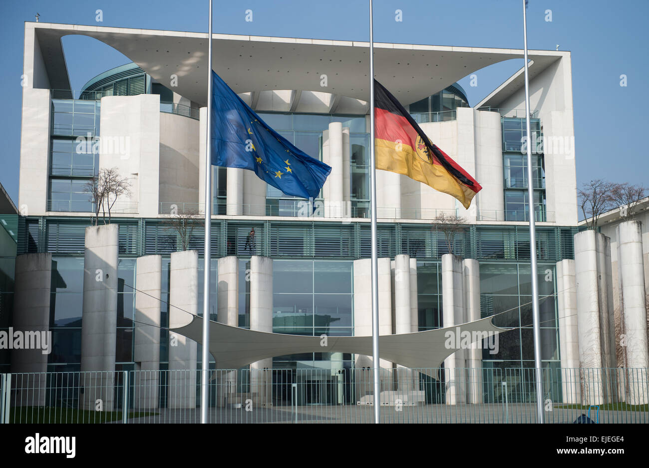 Berlin, Germany. 25th Mar, 2015. The German and European Union flags hang at half mast in memory of the victims - Stock Image