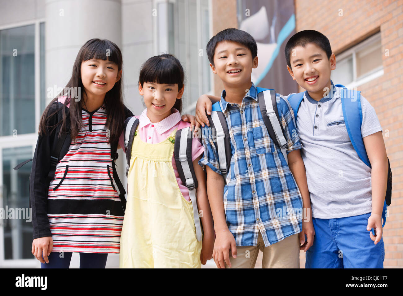The cute pupil at school arm around the shoulder - Stock Image