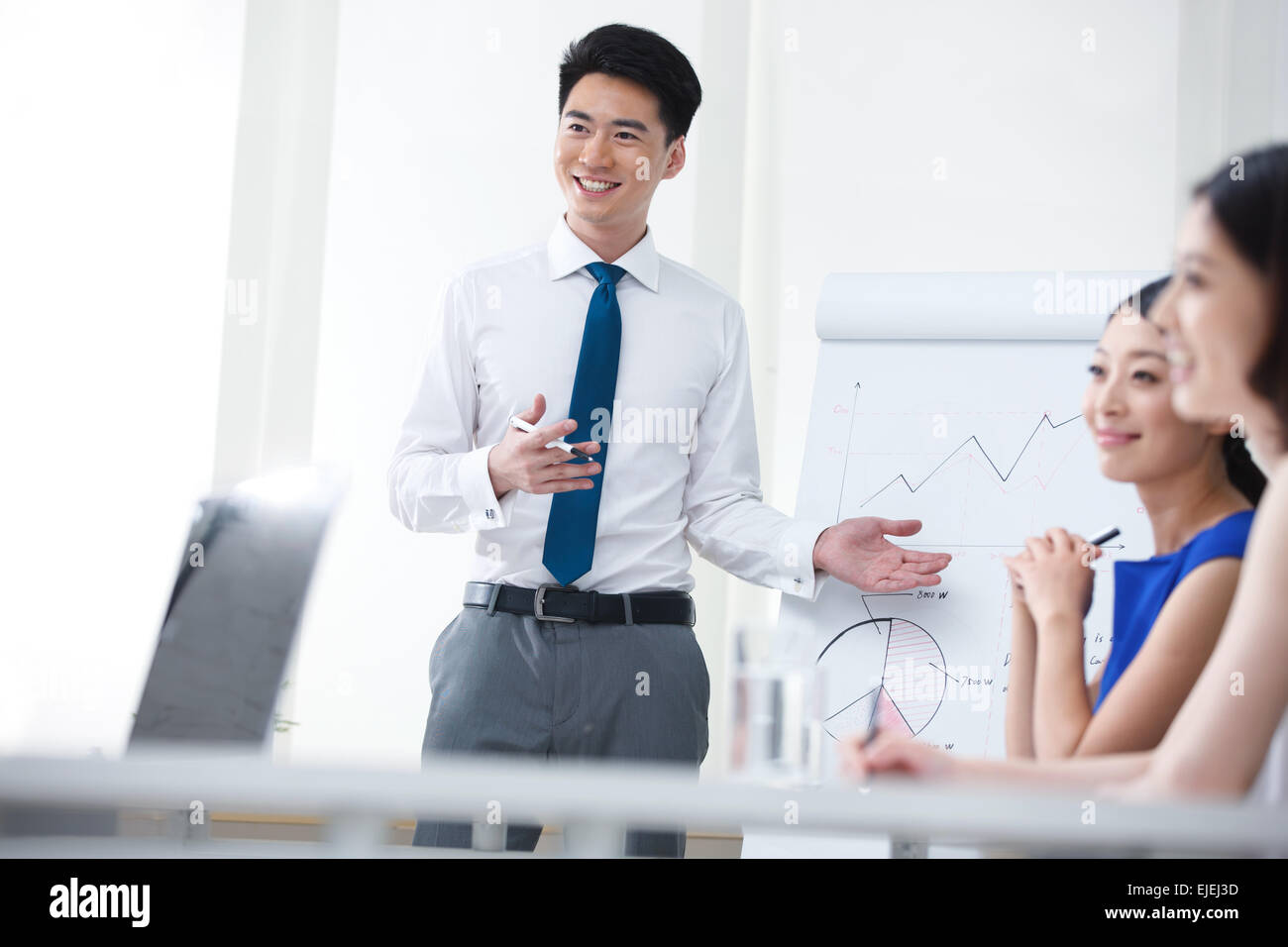 The young business people in the conference room Stock Photo