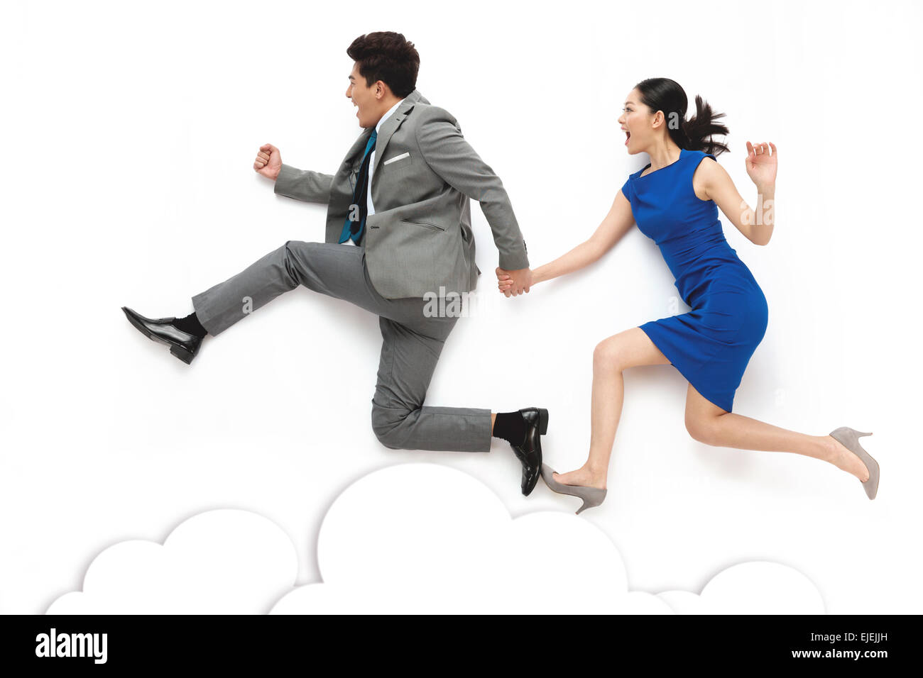 Business men and women holding hands run - Stock Image